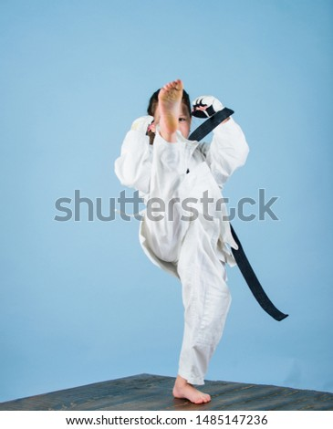 Girl little child in white kimono with belt. Karate fighter ready to fight. Karate sport concept. Self defence skills. Karate gives feeling of confidence. Strong and confident kid. She is dangerous. #1485147236