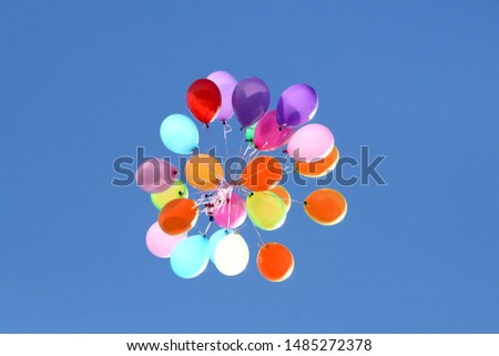bunch of colorful balloons against the blue sky. Holiday Decorations