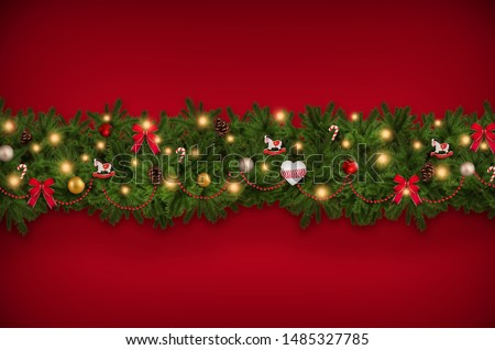 Christmas tree sprigs with decorations, red background