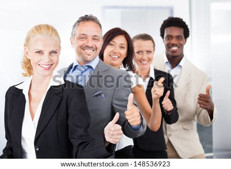 Group Of Happy Multiracial Businesspeople Standing In A Row #148536923