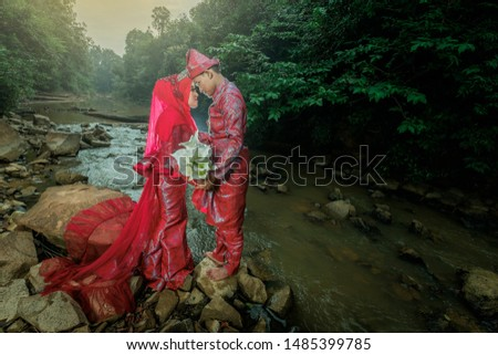 Muadzam Shah , Malaysia- August 17th,2019 : Attractive young wedding couple standing on rocks next to river variation. Newlyweds photoshoot. #1485399785
