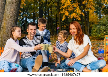 happy big family in the park on a picnic. Dad Mom, children, son, daughter. Autumn Halloween #1485407675