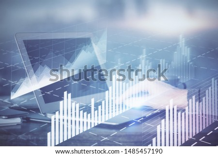 Double exposure of man's hands writing notes with laptop of stock market with forex graph background. Top View. Concept of research and trading. #1485457190