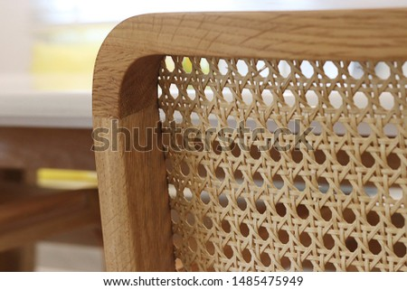 Closeup of wood chair with rattan, Beautiful  oak wood texture surface , rattan pattern. Royalty-Free Stock Photo #1485475949