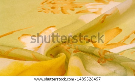 Texture, background, thin translucent silk with a large pattern. On a yellow background - lettuce and orange flowers, each with its own pattern, which makes the overall composition a bit abstract. #1485526457