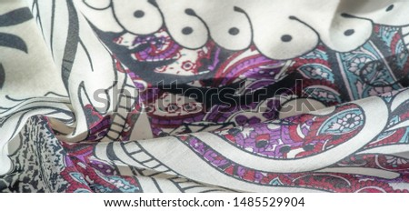 Background texture. cotton women scarf black and white pattern on one side of the scarf and color paisley pattern on the other side #1485529904