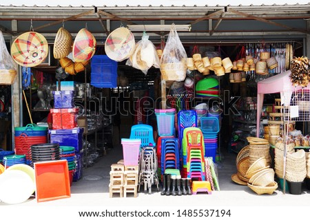 Miscellaneous street shop. Traditional of store front of miscellaneous shop that selling cooking stuff, cleaning tools, plastic chairs and household items for street food hawkers and houses. Thailand. Royalty-Free Stock Photo #1485537194