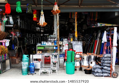 Miscellaneous street shop. Traditional of store front of miscellaneous shops that selling charcoal burning stove, folk fishing tools, and household items for street cart hawkers and houses. Thailand. #1485537920