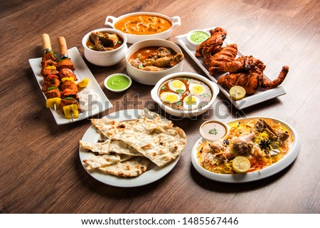 Assorted Indian Non Vegetarian food recipe served in a group. Includes Chicken Curry, Mutton Masala, Anda/egg curry, Butter chicken, biryani, tandoori murg, chicken-tikka and naan/roti for ramadan #1485567446