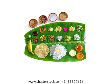 Traditional food Onam Sadya served on a banana leaf on Festival day onam,  Vegetarian meal with rice and curries, kerala food, Kerala, india #1485577616