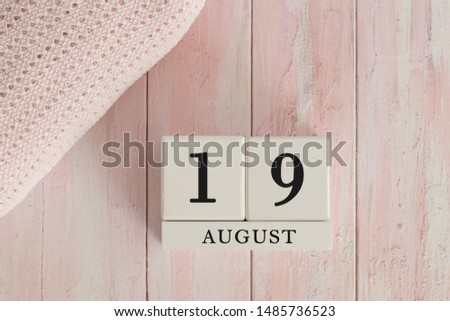 19 August Date on Cubes. Date on painted pink wood, next to baby blanket. Theme of baby due dates and birth dates. #1485736523