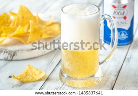 SUMY, UKRAINE - JUNE 12, 2019: Mug of Kronenbourg 1664 Blanc beer. Kronenbourg 1664 Blanc is premium-class pale lager, particularly popular in Europe. #1485837641