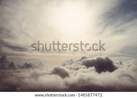 White clouds, sky view from plane. gloomy sky with rainy gray clouds #1485877472