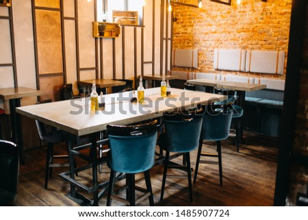 ozy wooden interior of restaurant, copy space. Comfortable modern dining place, contemporary design background #1485907724