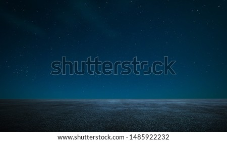 Empty asphalt floor with night sky . Royalty-Free Stock Photo #1485922232