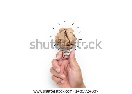 Creative idea. New idea, innovation and solution concepts.hand holding  lightbulb on white background.Business solution,planning ideas.glowing contents #1485924389
