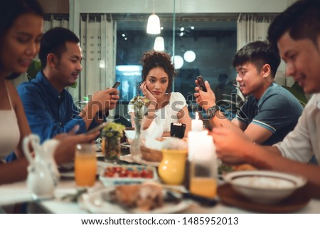 Asian women Know bored At her friend Playing phone while eating #1485952013