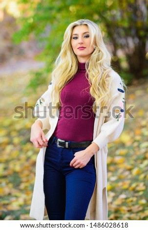 Girl stylish outfit with soft wool or cashmere cardigan. Woman wear long knitted cardigan while walk in park. Fall fashion cozy cardigan. Feel so warm and comfortable. Autumn fashionable cardigan. #1486028618