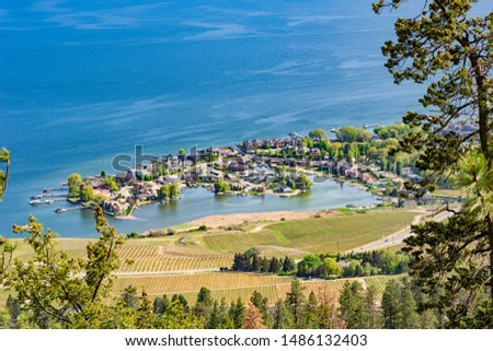 A view of Green Bay subdivision and Okanagan Lake from Mount Boucherie in West Kelowna British Columbia Canada in the summer #1486132403