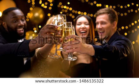 Cheerful multi-racial friends clinking champagne glasses, corporate event, fun #1486135322