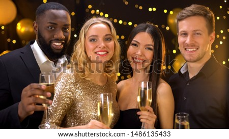 Multi-racial group of friends holding glasses of champagne, smiling on camera #1486135433