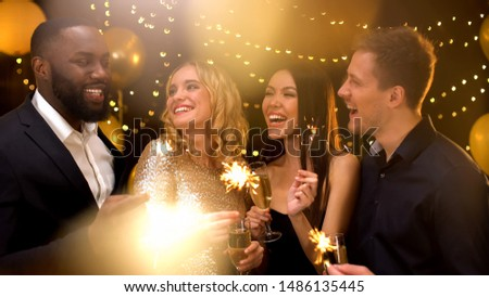 Cheerful multi-racial friends with bengal lights having fun at party, night club Royalty-Free Stock Photo #1486135445