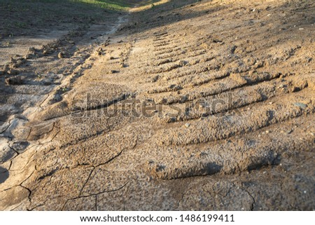 Bulldozer tracks in the mud on a freshly excavated Construction Site in Madison, Wisconsin. #1486199411