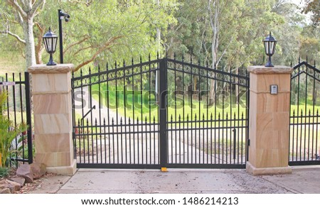 Automatic swing open metal front gates with stone pillars and lights either side #1486214213