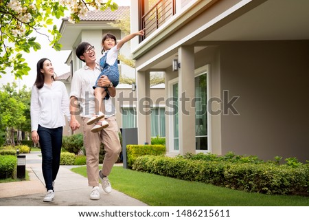 Beautiful family portrait smiling outside their new house with sunset, this photo canuse for family, fathe, mother and home concept #1486215611