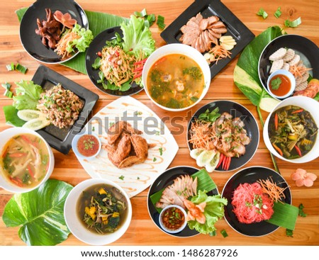 Table food served on plate / Tradition northeast food Isaan delicious on plate with fresh vegetables - Many variety various Thai menu Asian food on a wooden table , food asean top view #1486287926