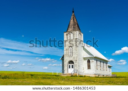 The historic Immanuel Lutheran Church in Admiral, Saskatchewan with a canola field in the background #1486301453