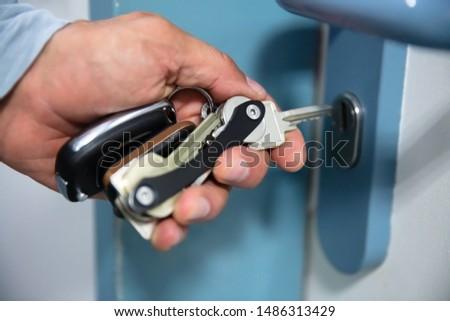 Man Using Key Organizer To Open Door #1486313429