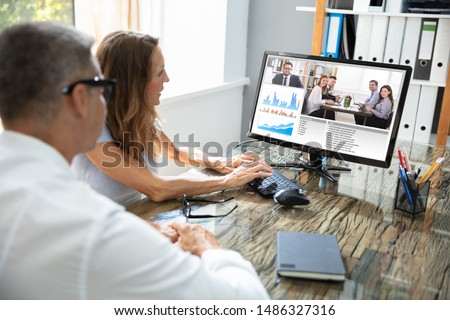 Mature Businessman Video Conferencing With His Colleague On Computer #1486327316