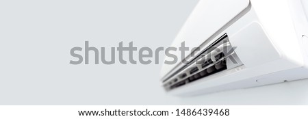 Air conditioner split hanging on the wall. Cooling device in room. Royalty-Free Stock Photo #1486439468