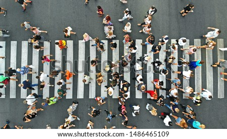 Aerial. People crowd on pedestrian crosswalk. Top view background. Royalty-Free Stock Photo #1486465109