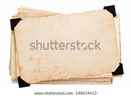 old grungy paper sheets isolated on white background. photo card with black corner