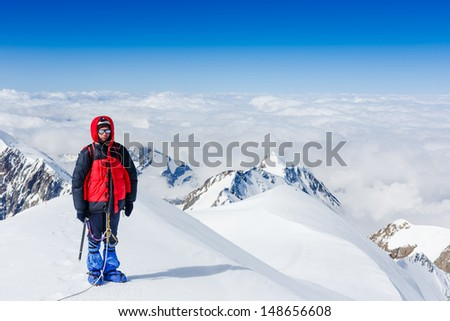 Young man trekking in the mountains  #148656608