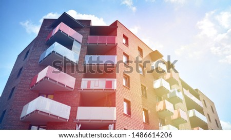 Modern apartment building detail, glass surface with sunlight #1486614206