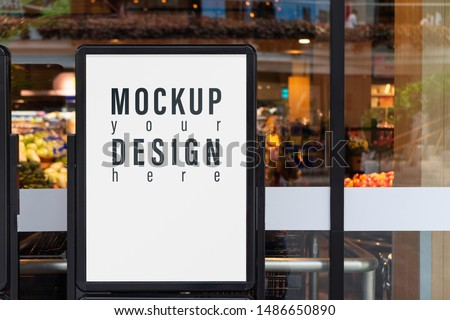 Mockup advertising board in front  of supermarket. Mock up billboard for your text messege or mock up content with department store or shopping mall background. #1486650890