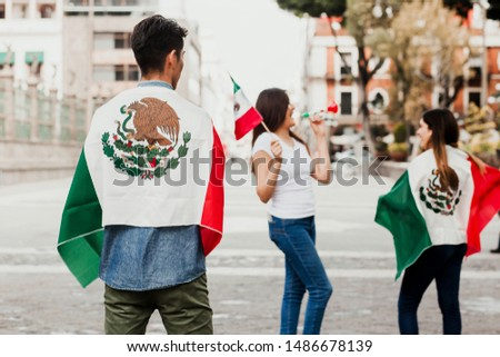 Mexican people cheering with flag of Mexico, Viva Mexico in Mexican independence day #1486678139