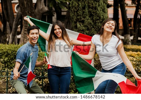 Mexican people cheering with flag of Mexico, Viva Mexico in Mexican independence day #1486678142