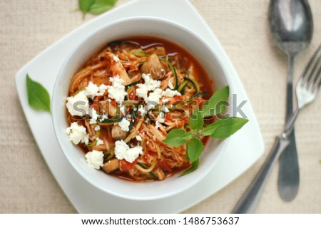 Zucchini spaghetti in sauce with tomato, basil, meat and cheese #1486753637