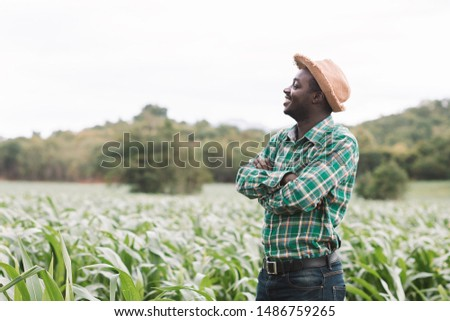 African farmer man stand at the green farm with happy and smile. #1486759265