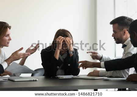 Stressed upset business woman suffer from angry colleagues clients arguing shouting at group meeting bullying humiliating female worker, harassment, stress and discrimination at workplace concept #1486821710