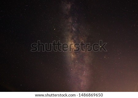 Clearly Milky Way Galaxy at night sky. Image contains grain, noise, blur and soft focus due to high ISO, Long Exposure and Wide Aperture.