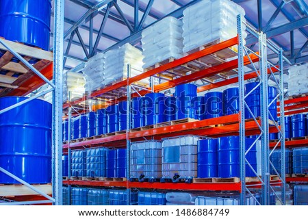 Chemical storage warehouse. Containers for chemical liquids. Warehouse system. Toxic barrels are kept in stock. Warehouse storage. Chemical Industry. Plastic barrels of chemicals are on pallets.  #1486884749