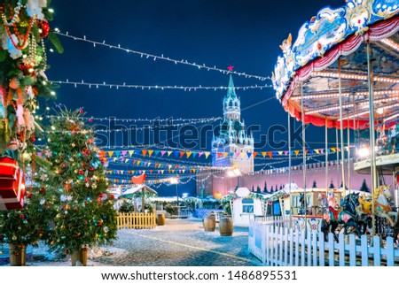 Russia. New Year Moscow. Christmas market. Christmas on red square. Kremlin. Kremlin wall. The city is decorated with garlands. Christmas trees and carousel on red square. Winter impressions of Russia #1486895531