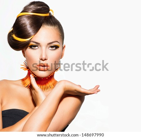 Fashion Model Girl Portrait with Yellow and Orange Makeup. Creative Hairstyle. Hairdo. Make up. Beauty Woman isolated on a White Background Royalty-Free Stock Photo #148697990