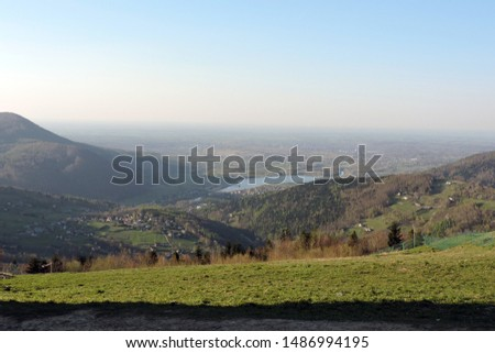 A view of a forest, the Soła river, the Międzybrodzkie lake and a city in the valley in the mountain range of Little Beskids in southern Poland #1486994195