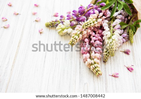 Pink  lupine flowers border on a old wooden background #1487008442